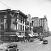 Main Street looking north at Third Street, Army Navy Store, Higgins Building, United Cigar Stores Company, office / retail building, City Hall in distance