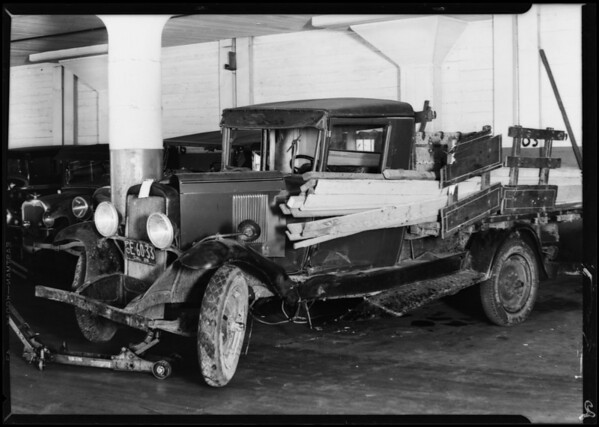 Wrecked cars, garage intersection at Melrose Avenue and North Highland Avenue, Los Angeles, CA, 1929