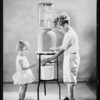 Children and water bottle in studio, Southern California, 1929