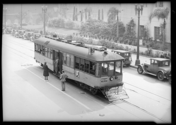 Bus, yellow and red car, Southern California, 1931