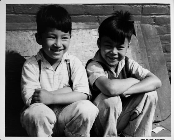 Two young boys smiling in Chinatown