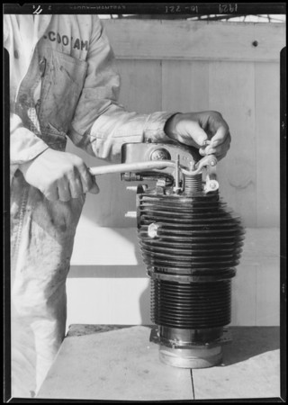 Close ups of working on motor, Southern California, 1929