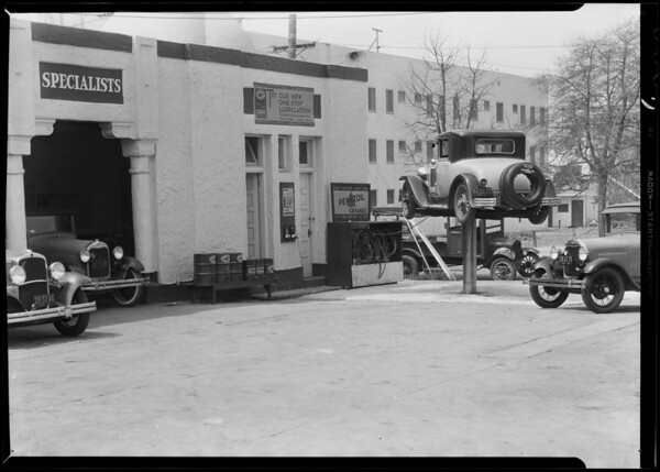 Cars & grease rack at service station, 4982 Hollywood Boulevard, Los Angeles, CA, 1931