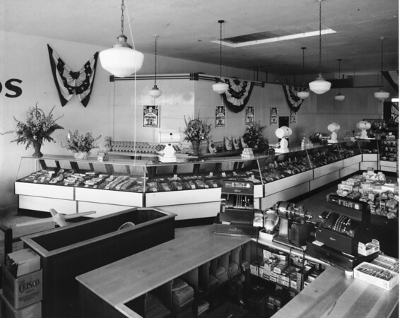 Inside a grocery displaying meat counter, possibly Vons grocery