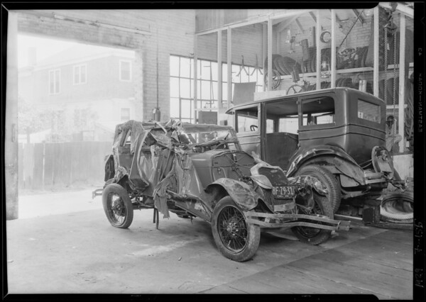 Wrecked Ford - which went into ocean, taken at garage 214 West 17th Street, Los Angeles, CA, 1929