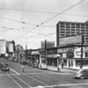 Main Street, looking north at Eleventh Street, The Main Round-Up Cafe, furniture stores, California Importing & Jobbing Company Building