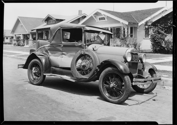 Wrecked Ford coupe, Southern California, 1931