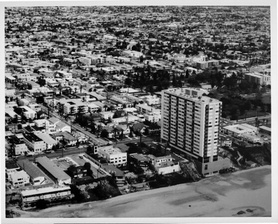Aerial view looking north-east over Long Beach at Ocean Boulevard and 14th Place, showing 1900 Ocean Apartment Community building