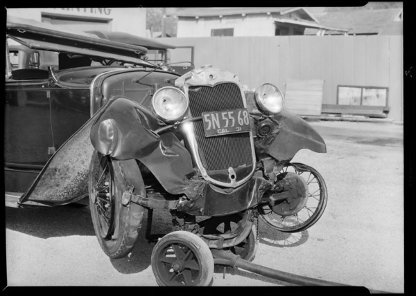 Wrecked Ford belonging to Mr. Grossman, York Boulevard, Los Angeles, CA, 1931