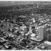 Aerial view facing northwest over Wilshire Boulevard and Western Avenue, Pierce National Life, Union Bank Building, Franklin Life