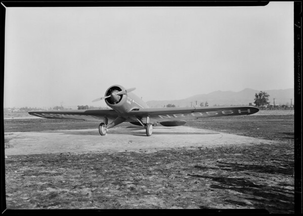 Lieutenant Bromly and his Lockheed plane, Southern California, 1929