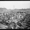 Yard full of burned cars at A-1 Auto Works after auto show fire, Los Angeles, CA, 1929