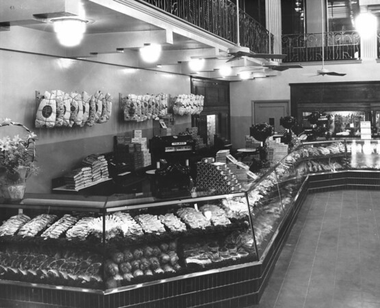 Inside a grocery displaying meat counter, deli