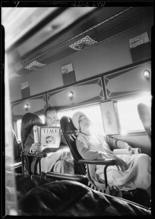 Reading Time magazine in plane, Southern California, 1929