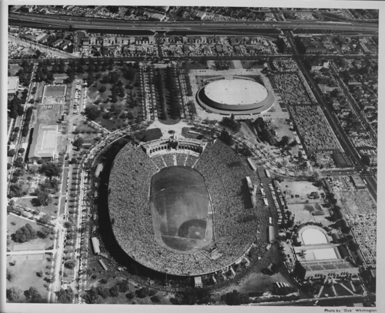Aerial photo facing east over the Coliseum and Sports Arena in Exposition Park.