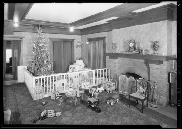 Christmas toys and the baby, Southern California, 1930