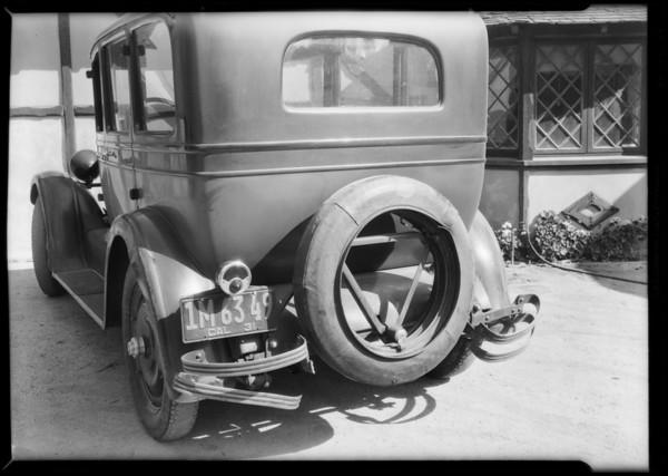 Rear view of Studebaker showing broken bumper, Southern California, 1931