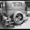 Rear view of Studebaker showing broken bumper, Southern California, 1931