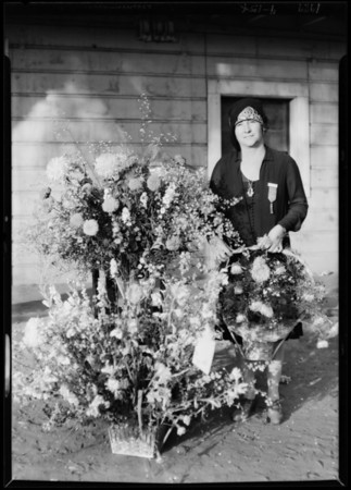 Woman and flowers at fair, Southern California, 1929