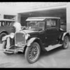 Dodge car at white garage on Cahuenga Boulevard, Los Angeles, CA, 1930