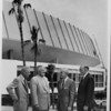 Los Angeles Sports Arena, business men in discussion outside Sports Arena, construction