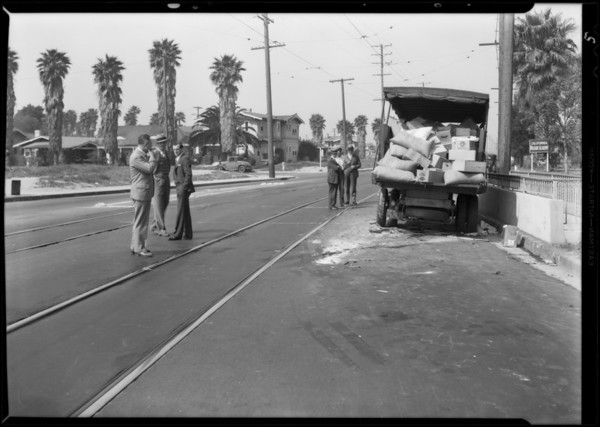 Truck wrecked by oncoming car, Pacific Wholesale Grocery Co., Los Angeles, CA, 1931