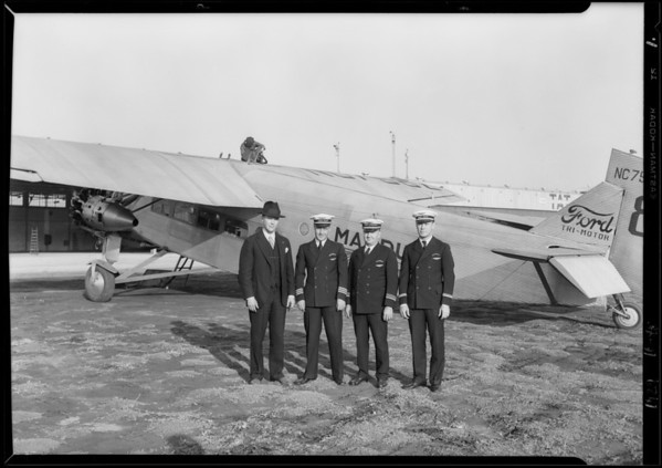 Group of Tomlinson, Preeg, Chief Engineer, and Chief Mate J. H. Black, Southern California, 1929