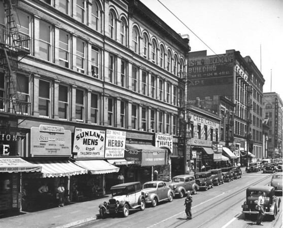 Main Street, looking north between Fourth Street and Fifth Street, Sunland Mens Store, 439 Main Street - General Army Navy Store, Rosslyn Theatre, Cafe Casino, Hotel Barclay