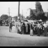 Auto wreck, people looking on, car turned over, Southern California, 1930