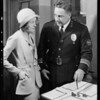 Police Chief Davis and girl, Southern California, 1931