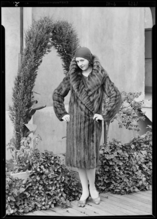 Model & fur coat on roof garden, Southern California, 1929