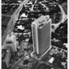 Aerial view of a tall building with a heliport