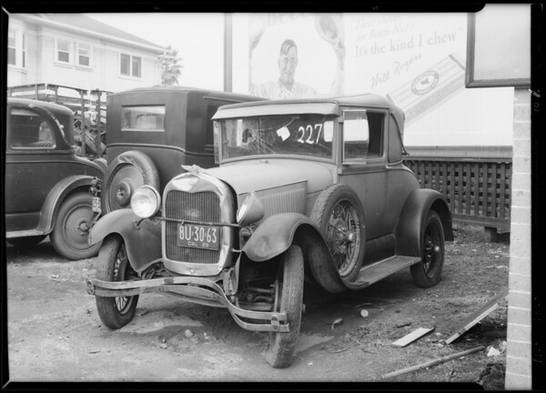 Wrecked Ford coupe at Stark's garage, Southern California, 1930