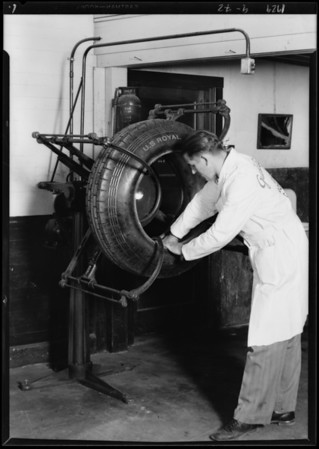Man inspecting tire, Southern California, 1929