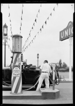 Filling car with 'Volatile Vapor', streamers from pump to sky, Southern California, 1931
