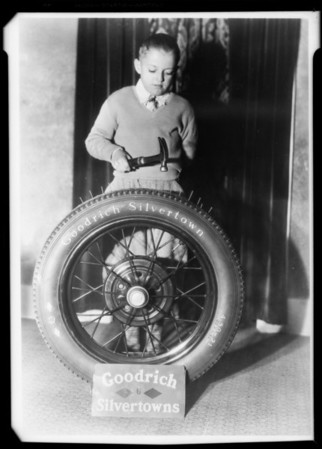 Boy and tire, Pacific Goodrich Co., Southern California, 1931
