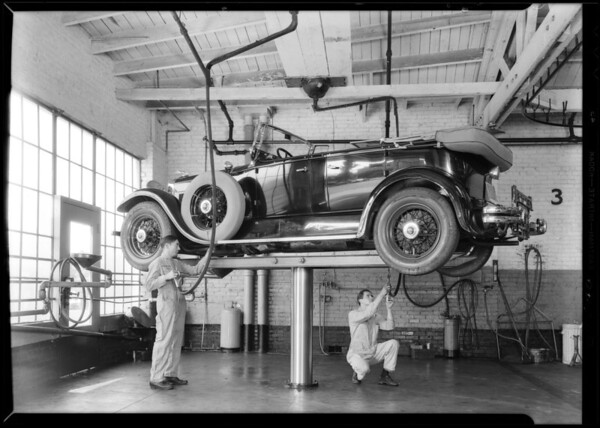 Greasing rack at Hollywood branch, Los Angeles, CA, 1930