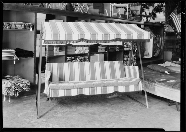 Couch and gas range stove, May Co., Southern California, 1931