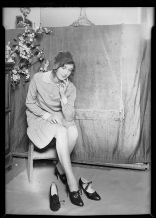 Trying shoes on girl, Star Shoe Co., Southern California, 1929