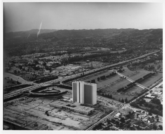Aerial view looking north down the San Diego Freeway (US-405) from Wilshire Boulevard. Federal Building at the Veterans Administration. Across Wilshire Boulevard is the Los Angeles National Cemetery