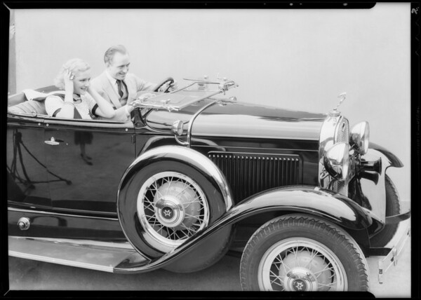 Couple in sporty Ford, also Ford truck, Southern California, 1931