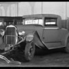 Wrecked Oldsmobile coupe and sedan belonging to Mrs. Olive Cardinet at Elite Garage, Southern California, 1931