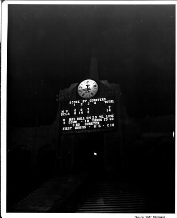 University of California at Los Angeles (UCLA) leads M.U. (Michigan?) in the third quarter during a night game at the Coliseum in Exposition Park