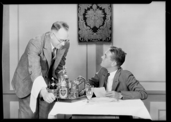 Jeffries & McKlean at table in studio, Southern California, 1929