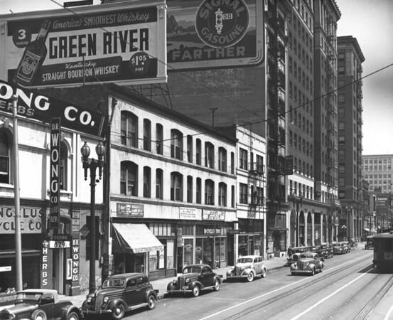Main Street looking north from 829 Main Street, D.R. Wong Company, Ohio Shoe Shop, Halls Key & Gun Shop, Broadway Cycle & Supply Company