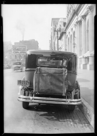 Car with trunks on back in front of Biltmore Hotel, Los Angeles, CA, 1930