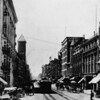Broadway looking south from First Street with office buildings, horse and buggy, and trolley cars