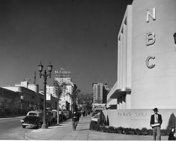 The NBC Radio City is foregrounded along Hollywood Boulevard from the corner of Wilcox Avenue