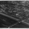 Aerial view, Downtown Los Angeles, Atcheson, Topeca & Sante Fe Railroads, bridge at Fourth Street, Hollywood Freeway (US-101). First Street, Cesar Chavez Street in background
