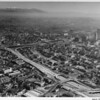 Downtown Los Angeles, aerial view from above the Harbor Freeway (I-110) looking northeast to City Hall, Hollywood Freeway (I-101)